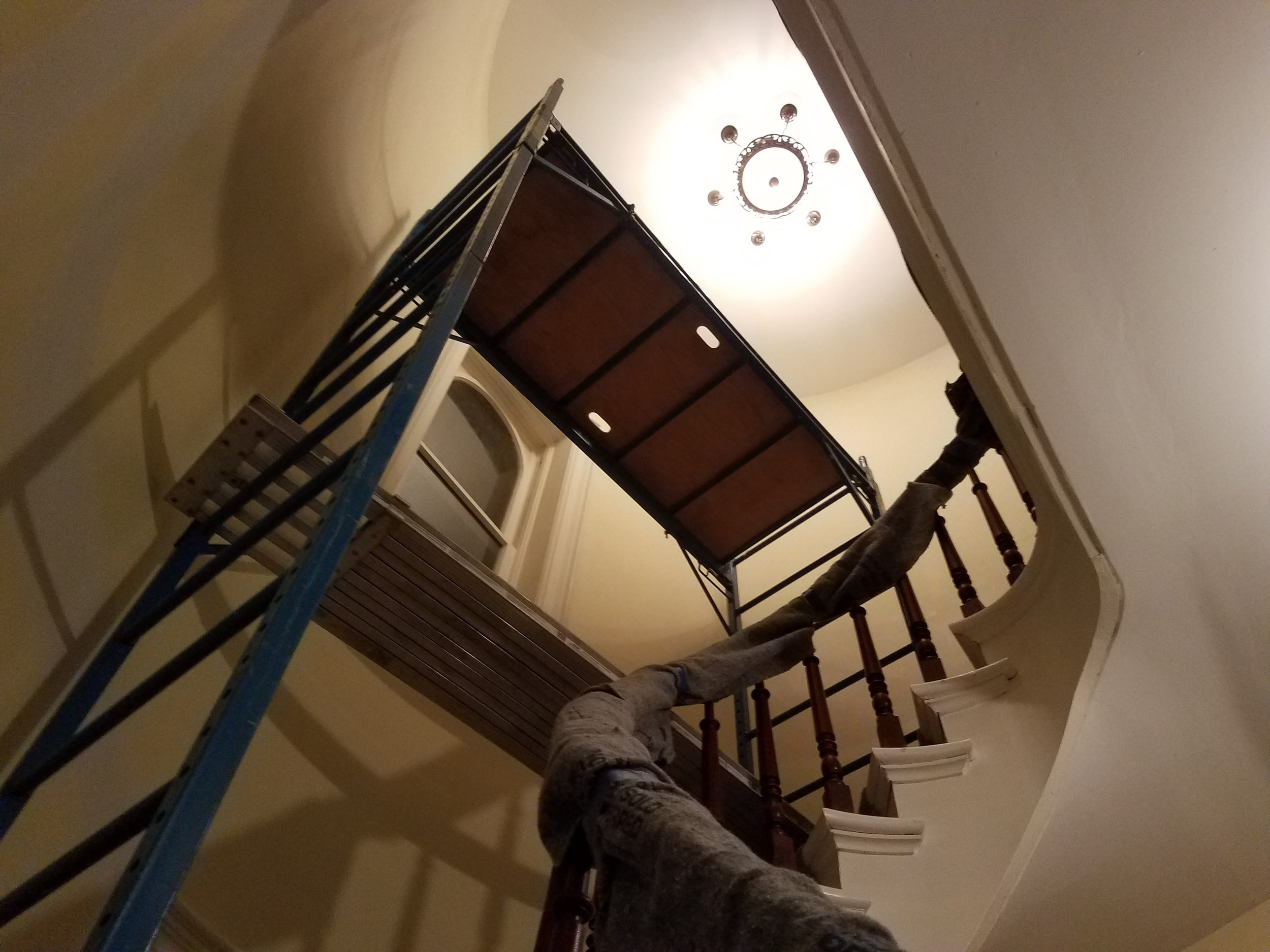 Scaffolding on a curved staircase can be spooky.