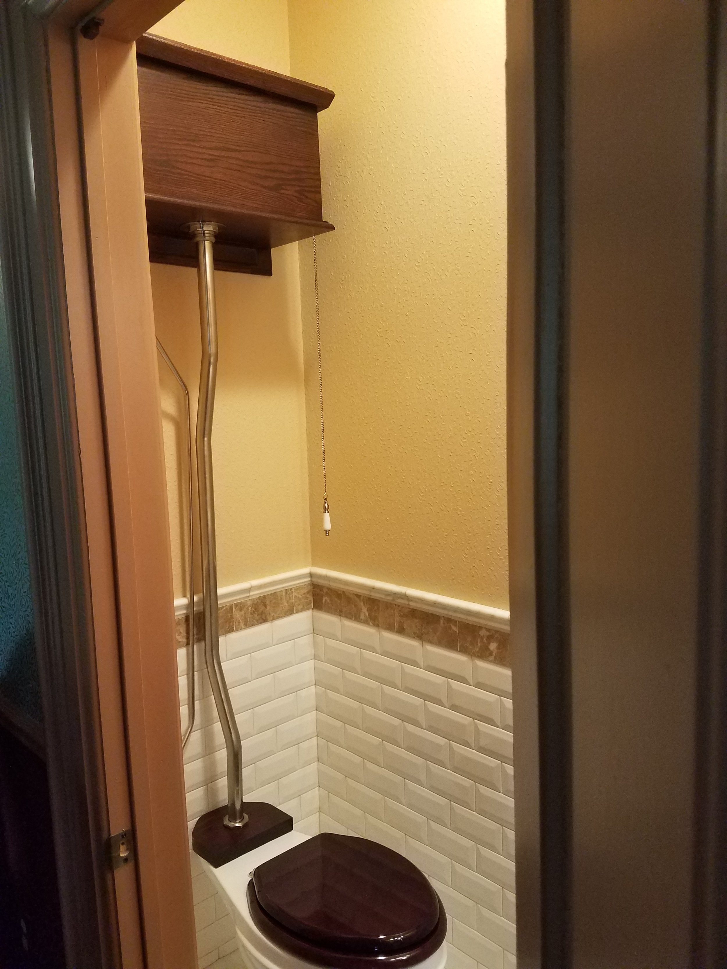 High back pull chain toilet.