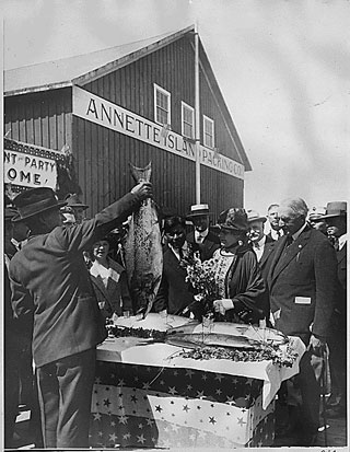 President Harding eyes salmon in Metlakatla during his visit. Image courtesy NARA.