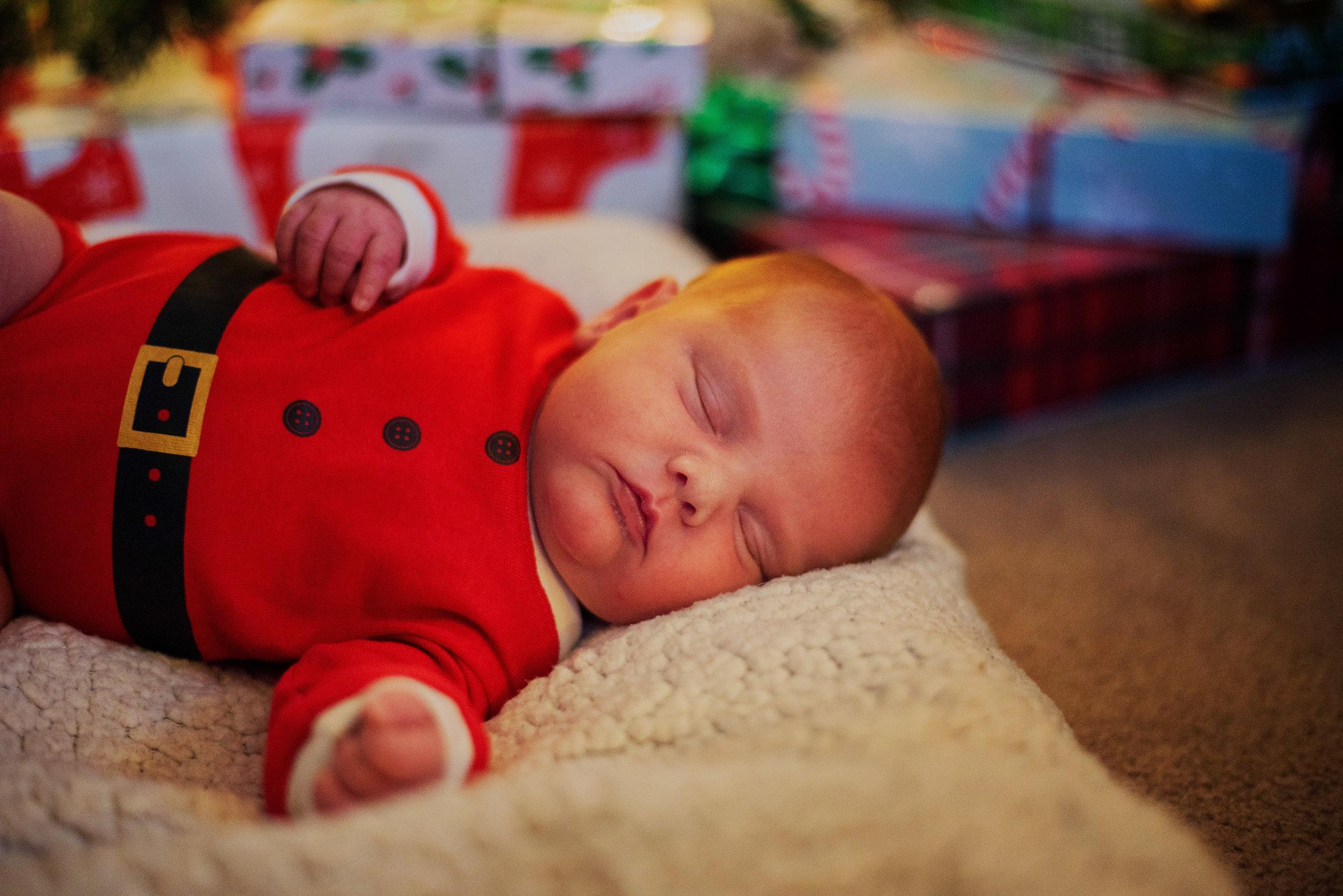 Planfield Santa onesie newborn session