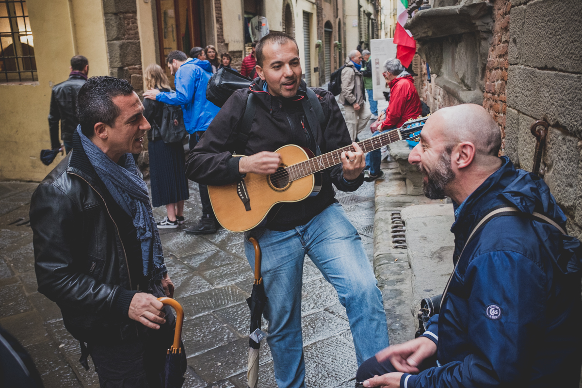 Good spirits in the streets of Lucca despite the rain