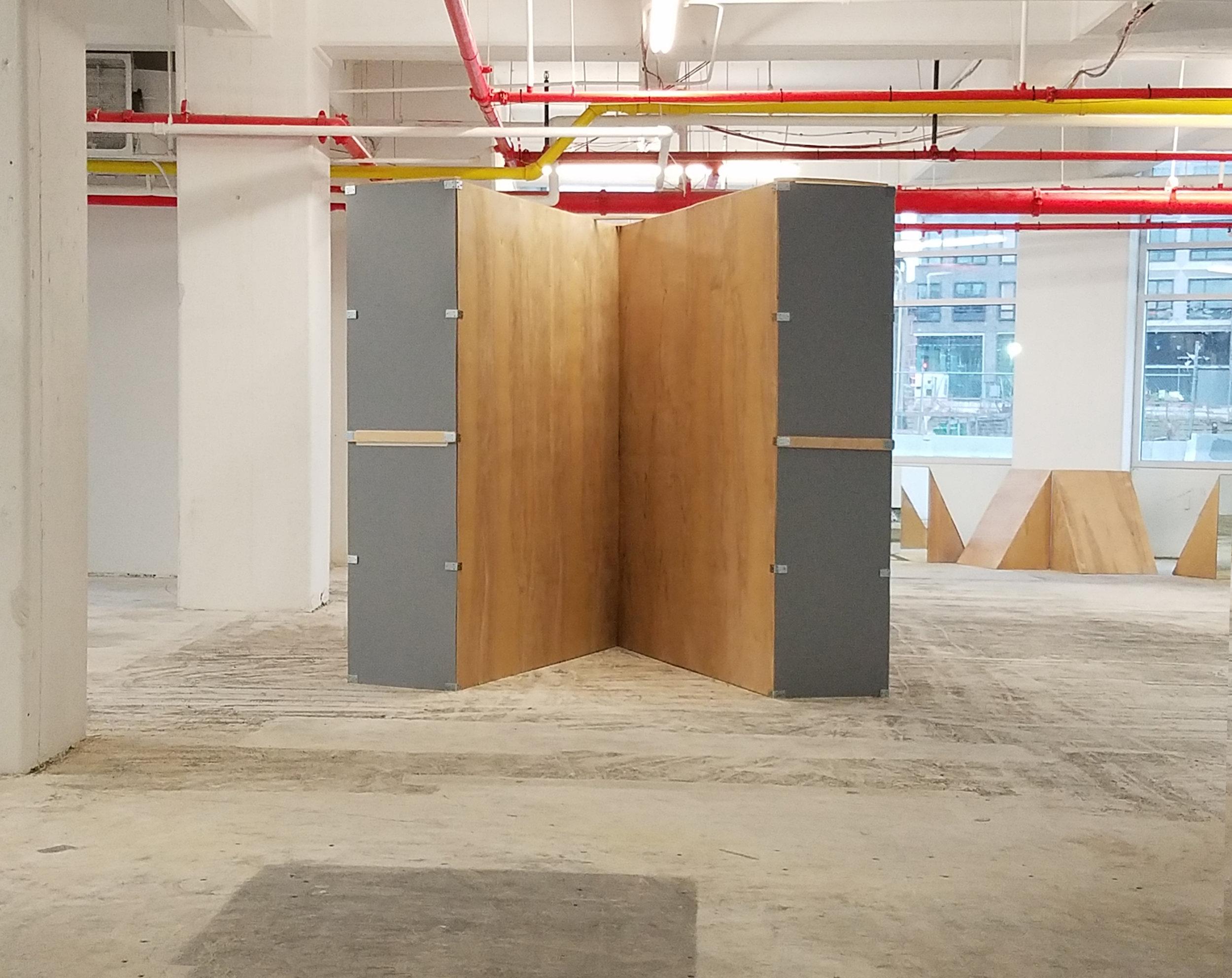 """Parallax 5  2×4s, plywood, paint, mirror 2017 96"""" × 120"""" × 90"""" Derek Frankhouser"""