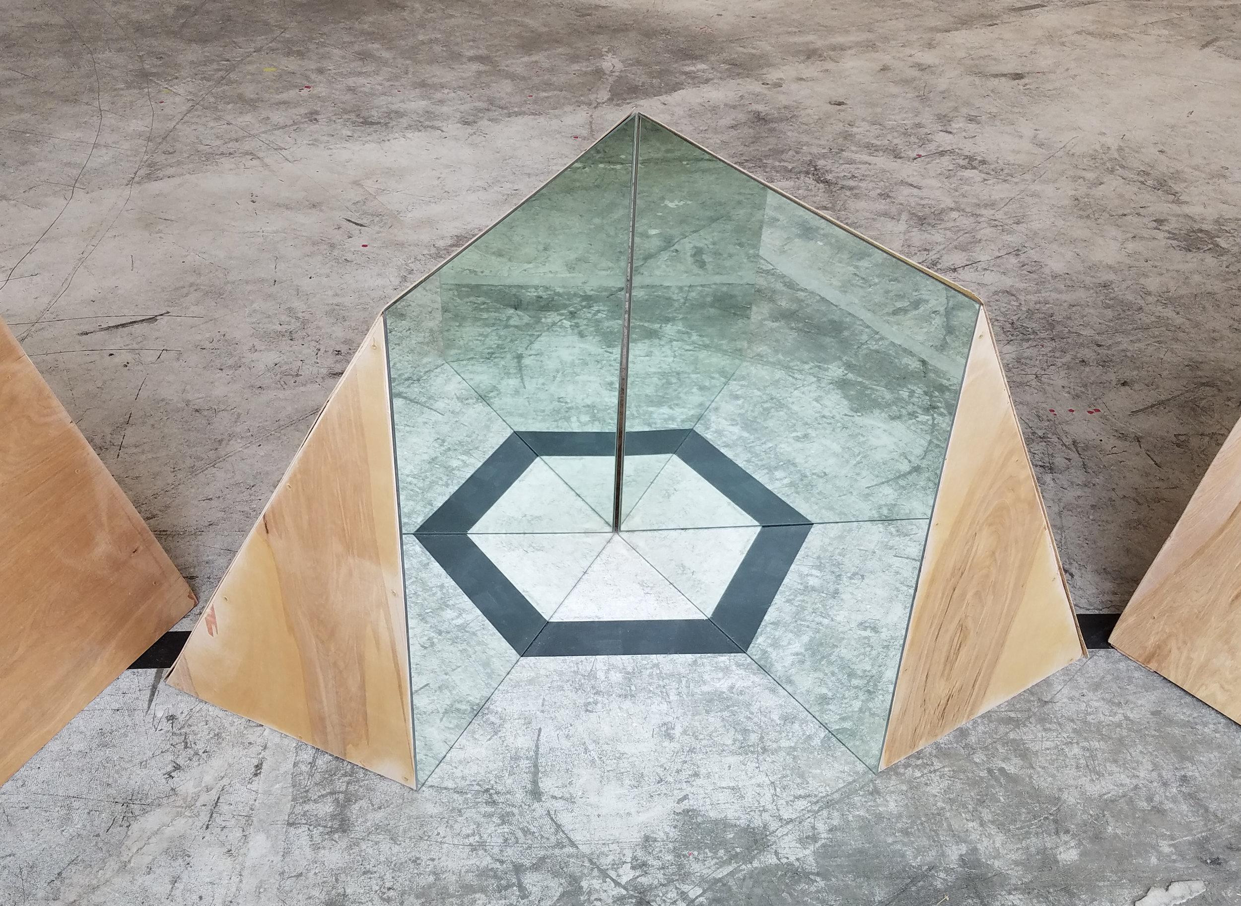 """Vertices  2×4s, plywood, mirrors, Gaff tape 2017 36"""" × 36""""× 1080""""(entire installation) Derek Frankhouser"""