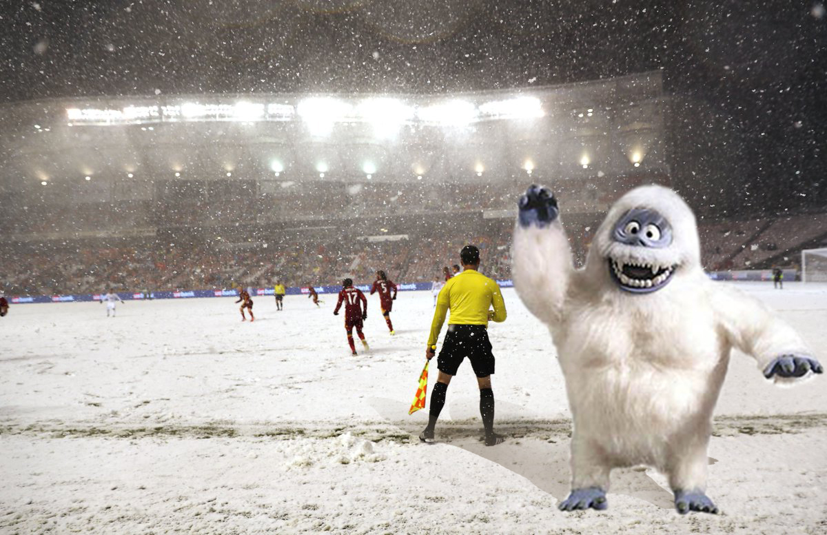 Assistant Referee Ian Anderson works in the shadow of a Yeti. NBD