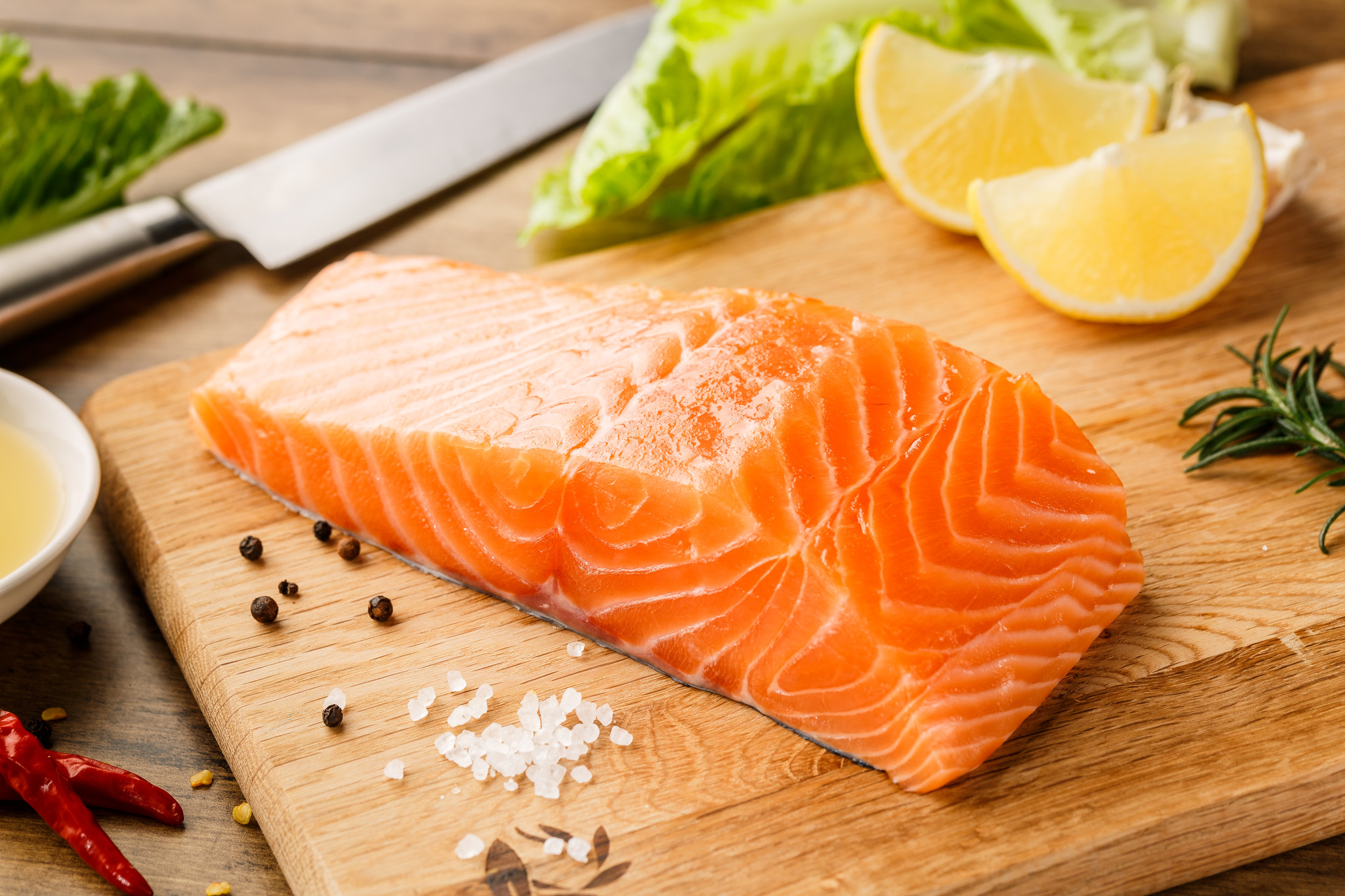 Wild salmon has a deep red color while farmed is often lighter with lots of white fat grains
