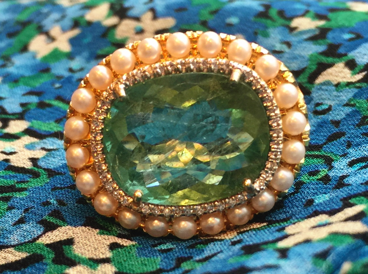 An Irene Neuwirth ring with green tourmaline,akoya cultured pearls and diamond pave.   Capitol.