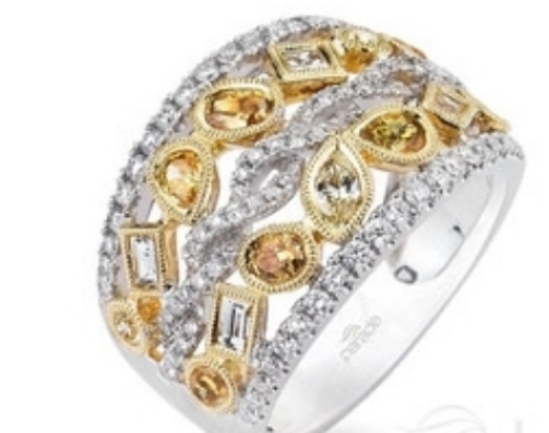 A Parade ring with more than a carat and a half of yellow and champagne diamonds set in two tones of gold. $8,100.   Donald Haack Diamonds  .