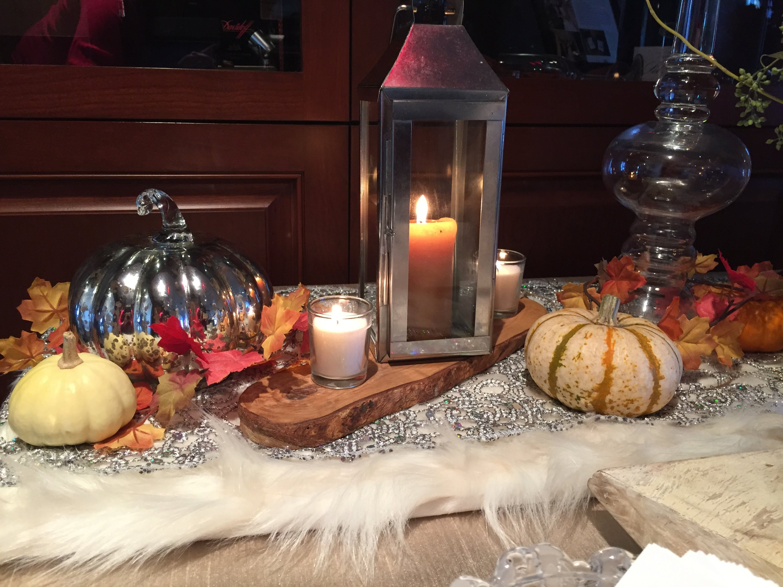 "Natural and classic elements will be on display at Portia's Thanksgiving table this year, with a bit of faux fur and crystal touches in honor of her ""diva glam"" grandmother."
