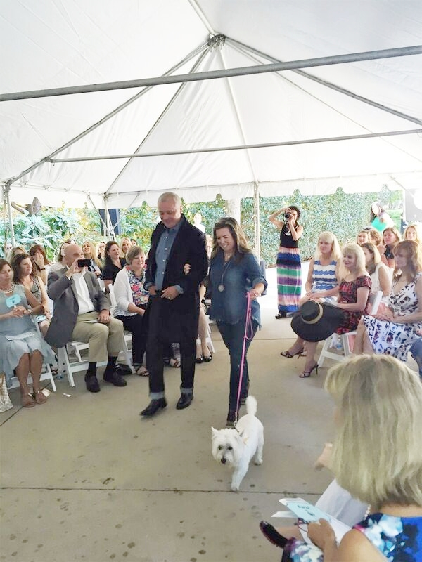 Mark and Terri Beattie walk the runway with one of the adoptable dog models.