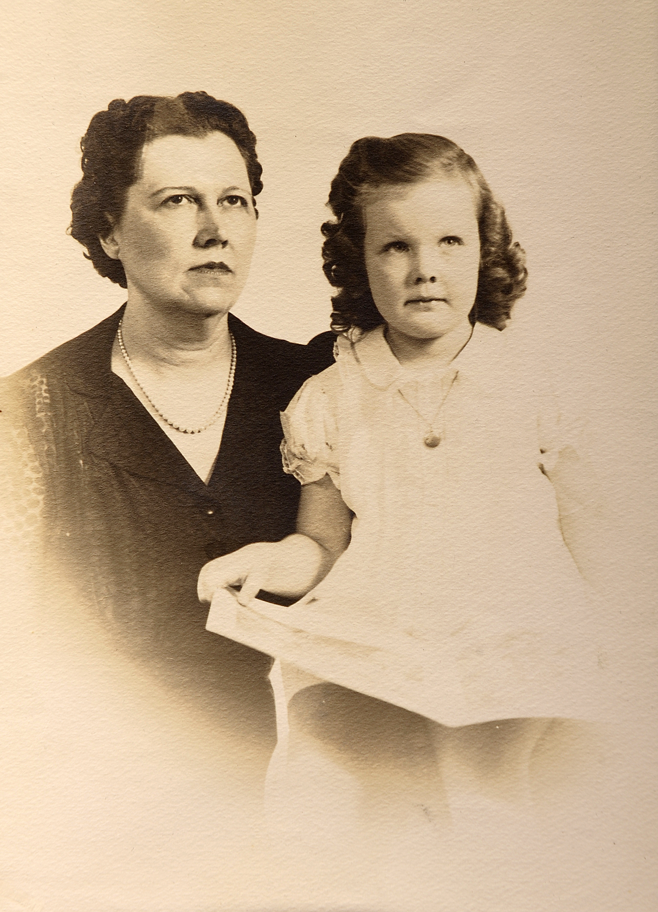 Sally with her mother, the owner of a popular women's clothing store in Wadesboro. As soon as Sally could demonstrate that she had proper etiquette skills and table manners, her mother began taking her on buying trips to New York City.