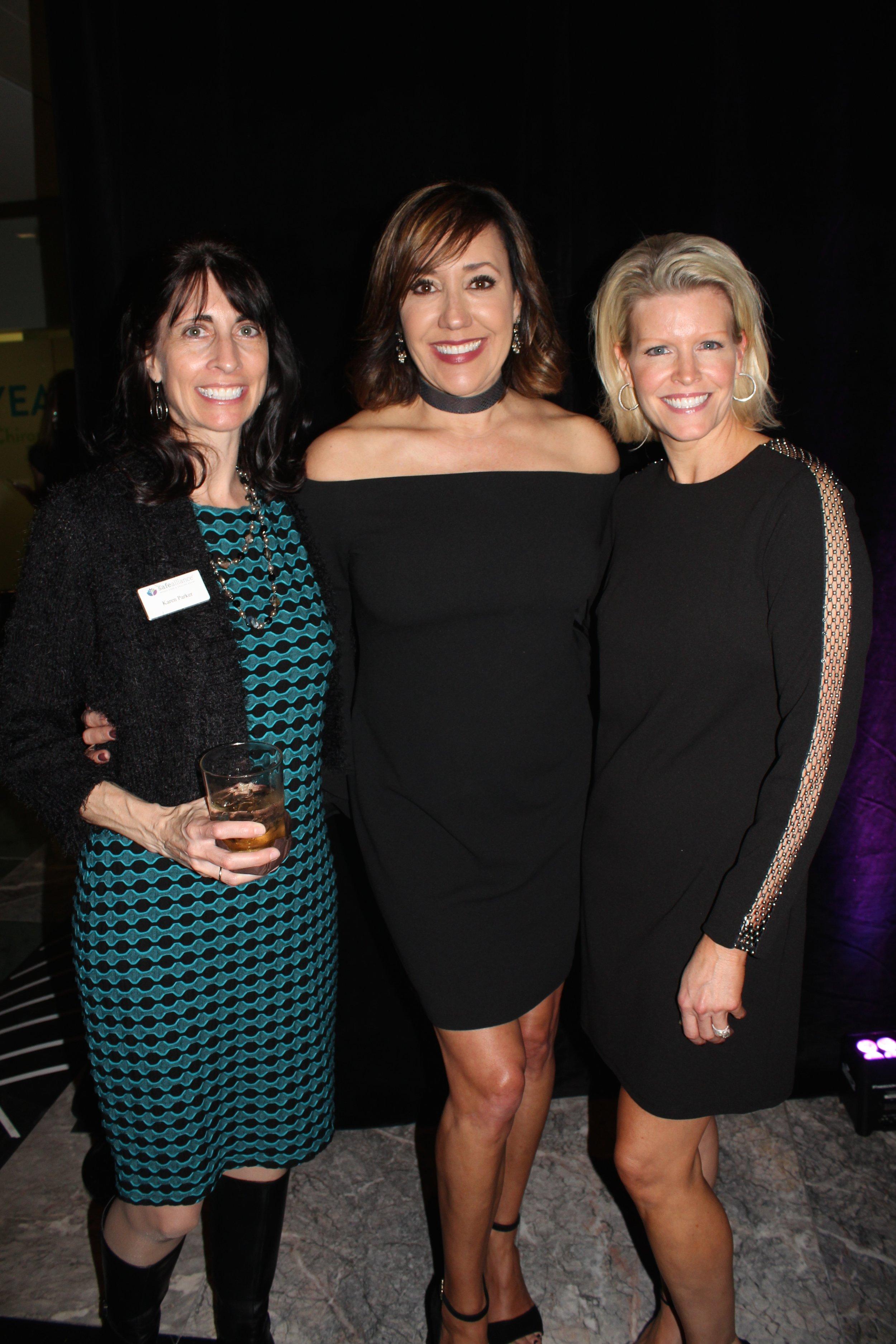 Safe Alliance CEO Karen Parker, emcee and WBTV anchor Maureen O'Boyle,and volunteer Joy Widener.