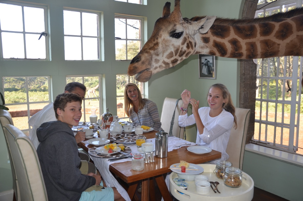 Leigh, her family and a special guest have breakfast at Giraffe Manor in Kenya.