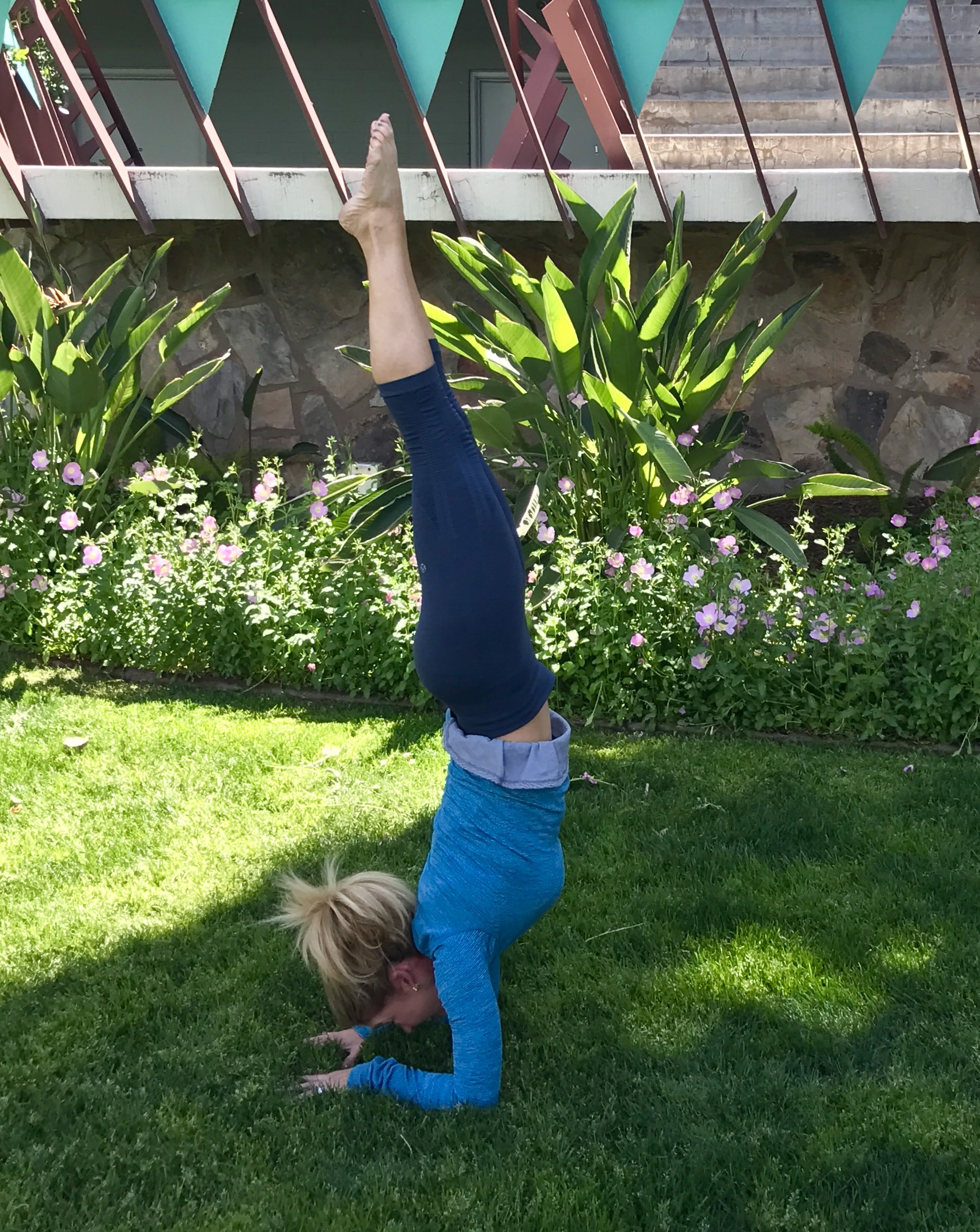 Leigh is an avid yogi, so even while in Phoenix March 3 to root for the UNC Tar Heels' victory in the NCAA Championship, she took an outdoor yoga class before the game.