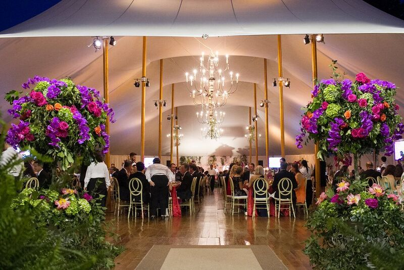 Two enormous and gorgeous floral displays from Watered Garden Florist at the tent's entrance.