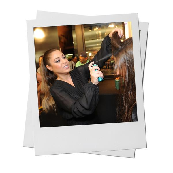 Rita Hazan applies her Root Concealer Touch Up Spray on a model's hair.