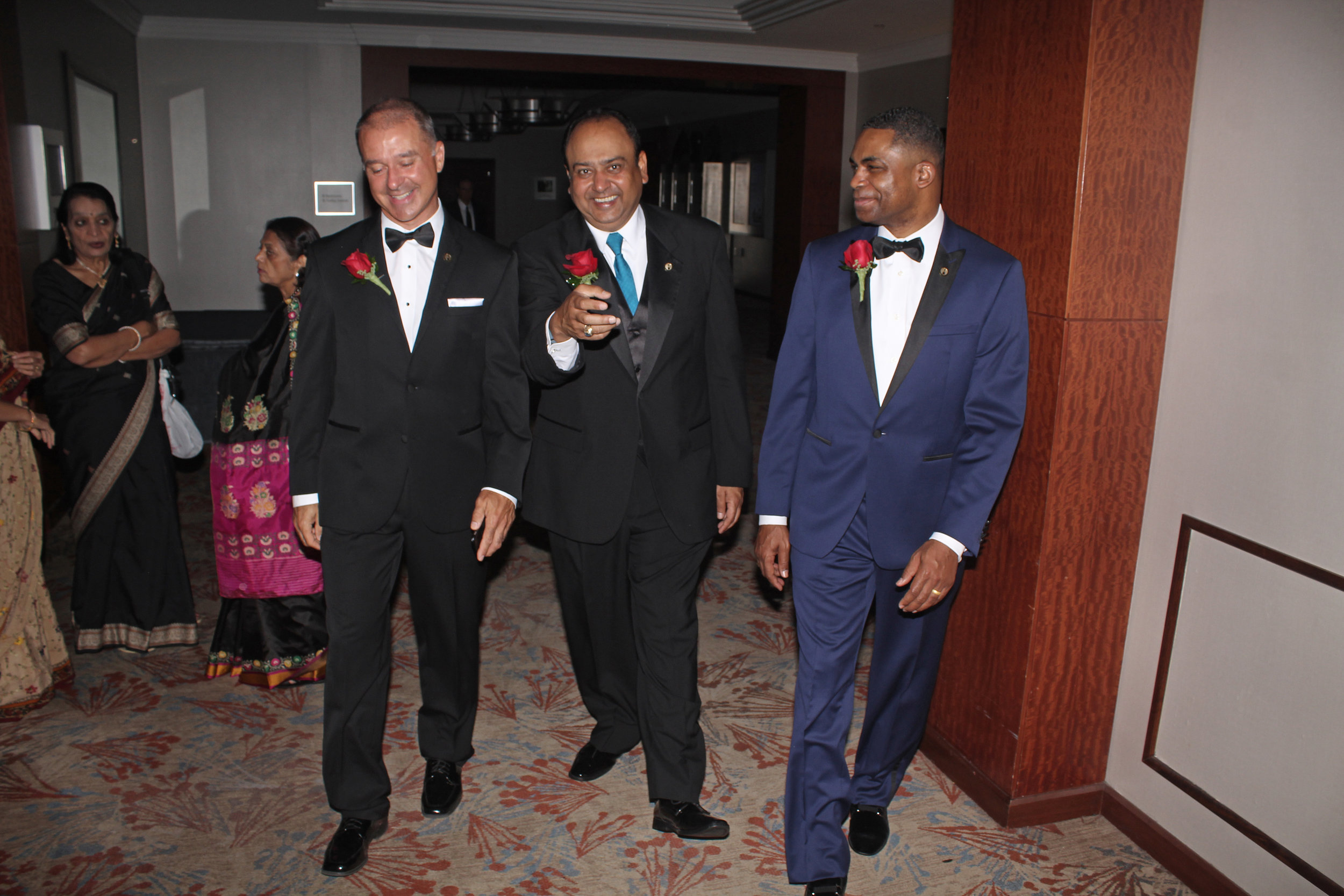 Dashing dads: The honorees make their entrance in style.