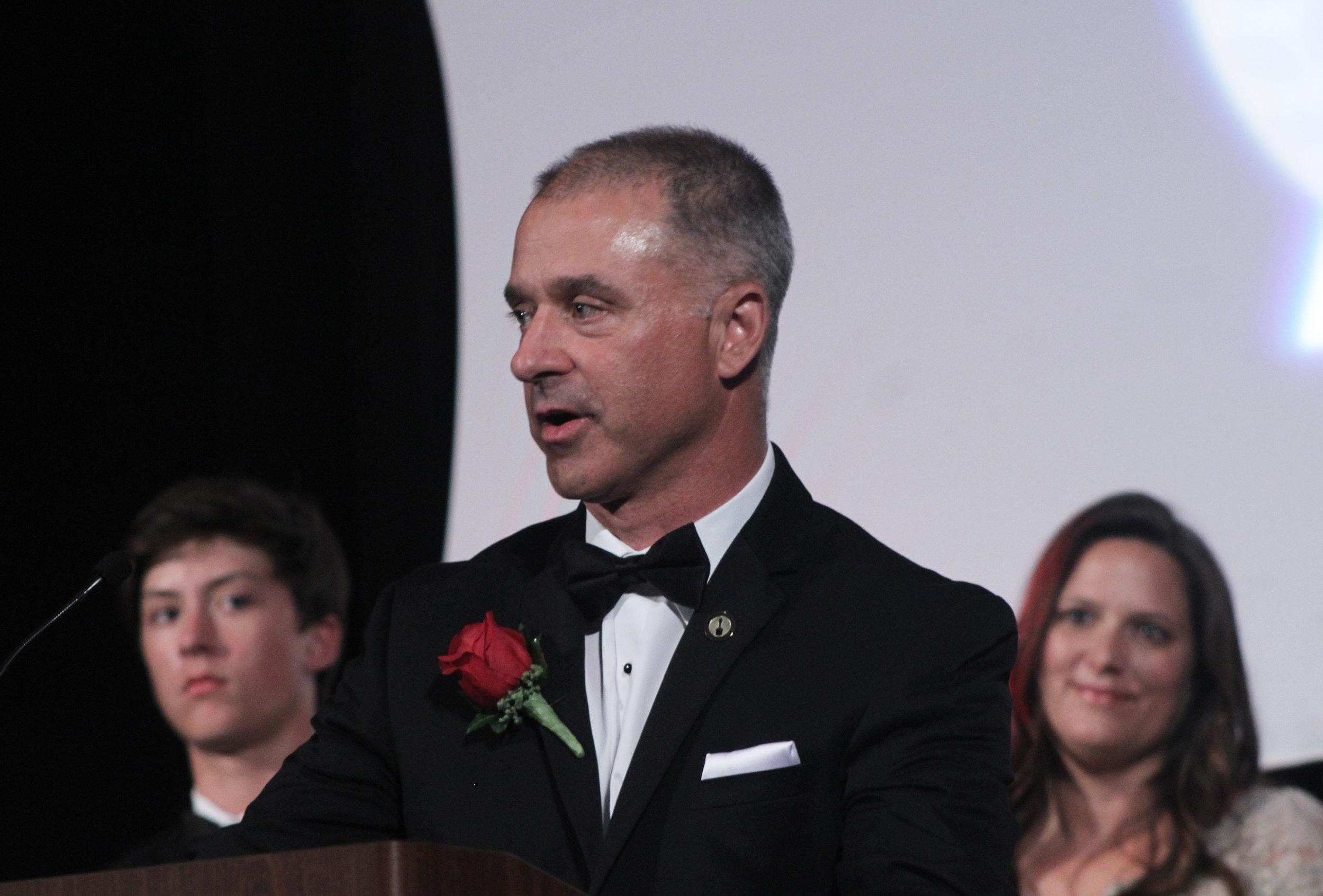 Chad Utermark accepts his award.