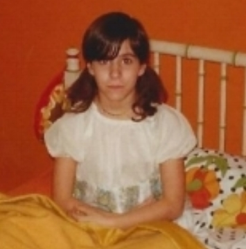 A tomboy in pigtails. Darla around age 11 in her super groovy 1970s bedroom that she loved.