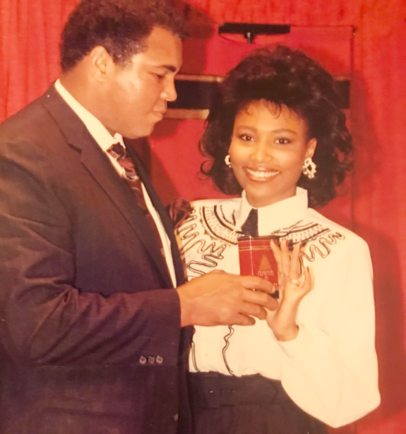Francene in a fragrance ad with famous boxer Muhammad Ali.