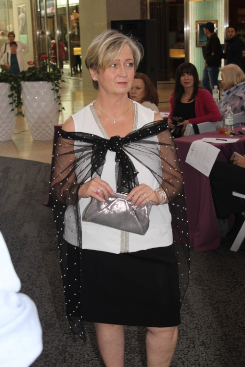 Suzanne Walker in an embellished wrap from Karl Lagerfeld and a silver Kate Landry clutch, both from Dillard's.