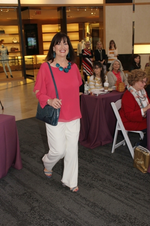 Dianne in a fuchsia Halston top, Preston & York white pants, Patricia Nash navy bag and Sam Edelman blue straw heeled sandals - all from Dillard's.