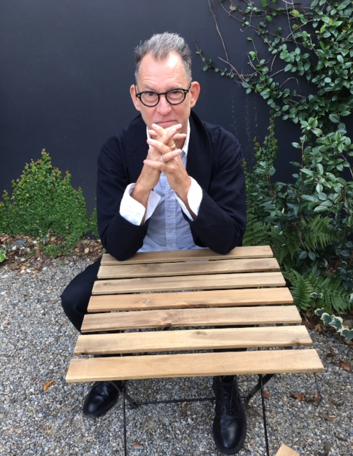 Fashion influencer Scott Newkirk, the buyer and creative director for Tabor, in the courtyard of the unique menswear store.