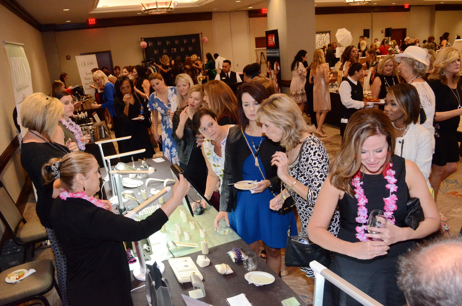 Guests shop at the Perry's Diamonds & Estate Jewelry booth.