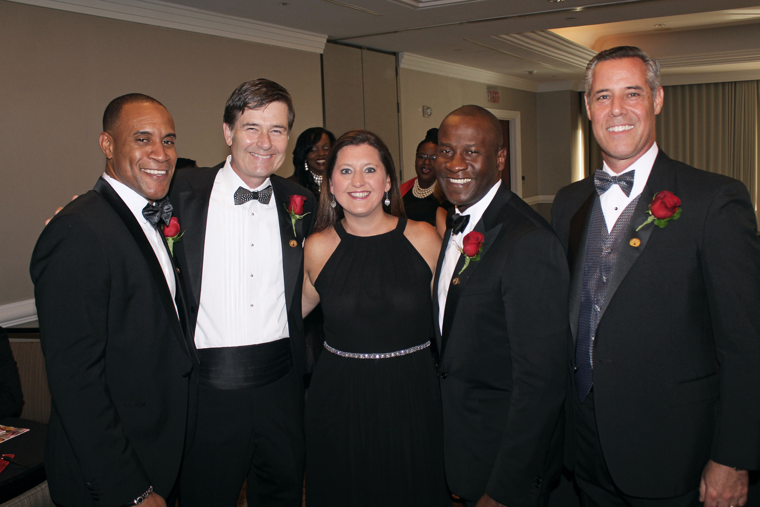 Christina Bickley with the American Diabetes Association in Charlotte surrounded by the Fathers of the Year.