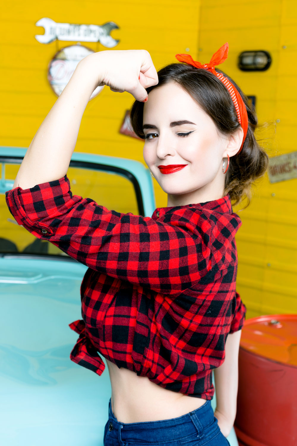 Pin Up girl with plaid shirt flexing her bicep