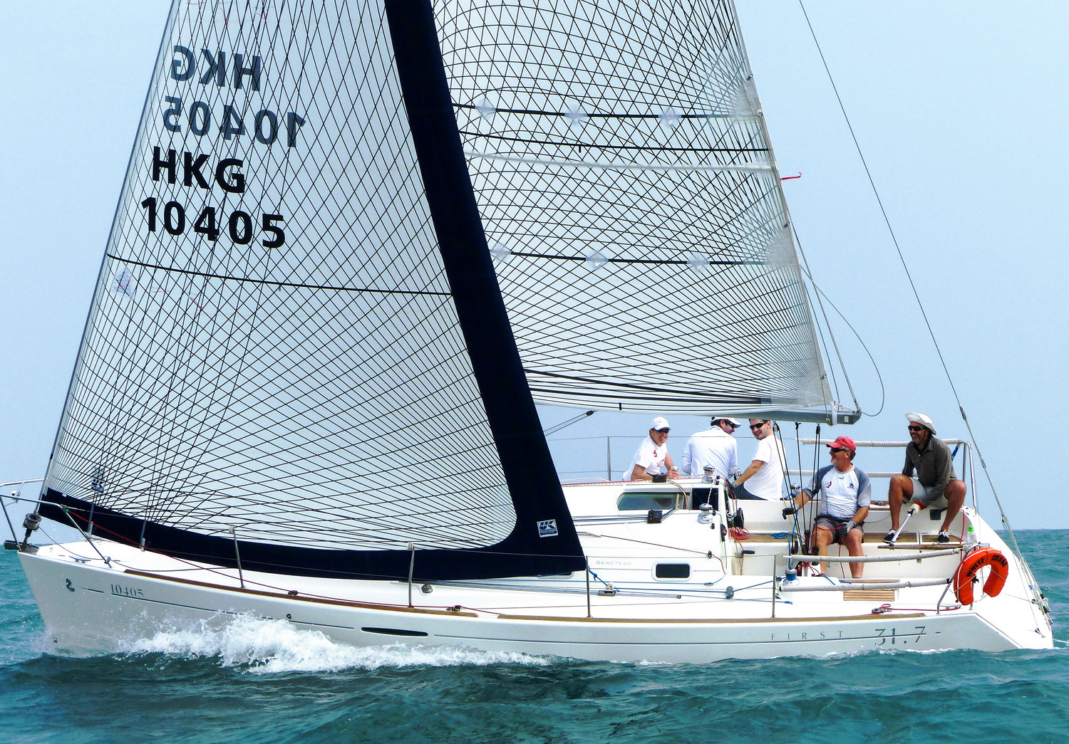 A Beneteau First 31.7 with Tape-Drive Carbon Polyester full-batten main and Passagemaker furling genoa.