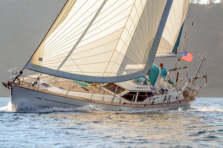 Roller-furling cruising radial Hydra Net® Passagemaker genoa and roller-furling mainsail with UV protection.   The Passagemaker's standard features are a foam luff for better reefing and furling, reefing reinforcements on the foot and leech and UV covers on the foot and leech.