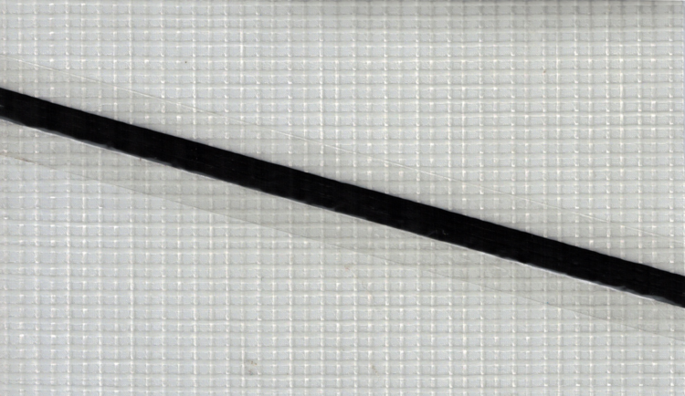 A single carbon tape on PM05T, the most commonly used polyester laminate for Tape-Drive sails.