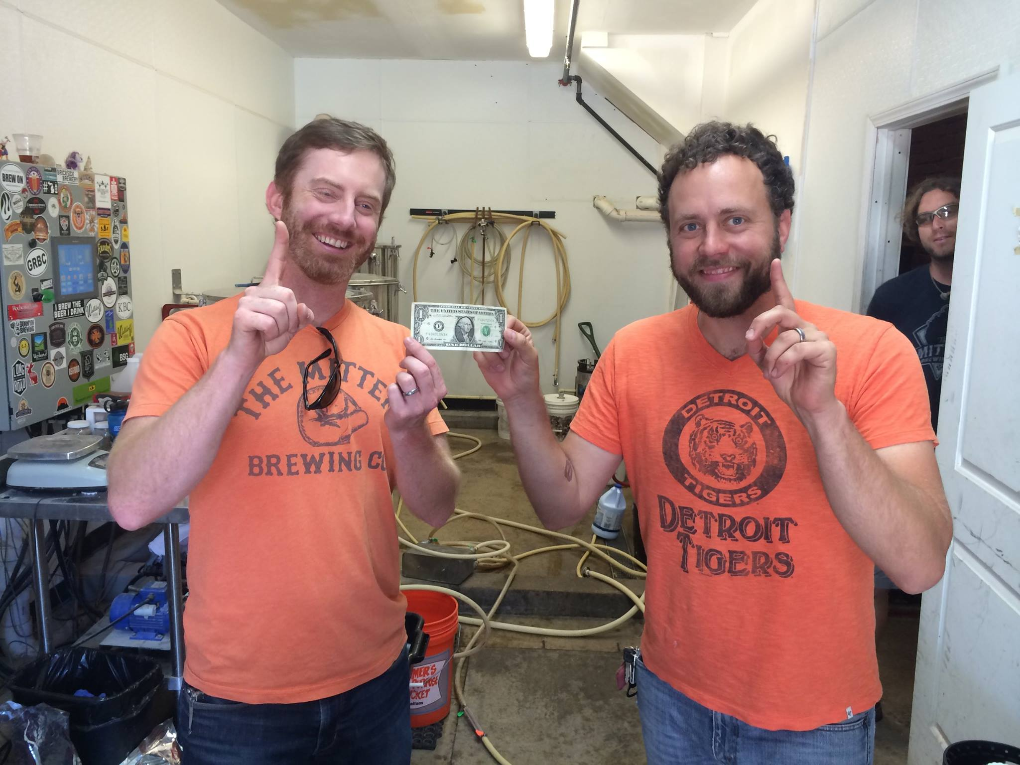 Co-Owners Max and Chris show off the 1st dollar earned. One down, a billion to go!