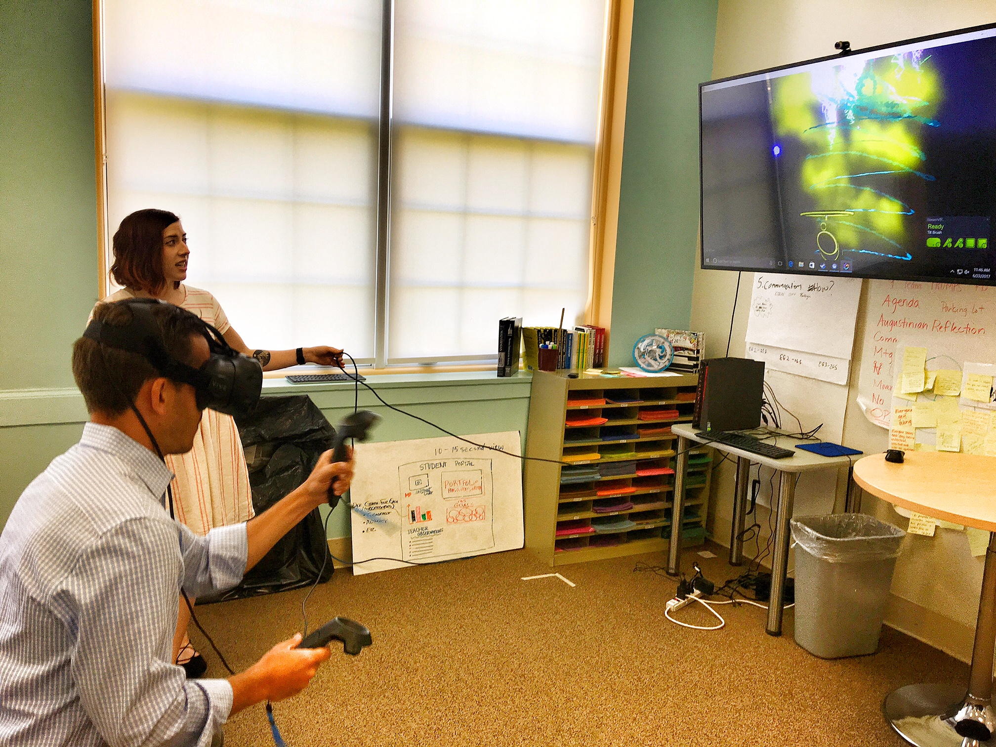 A participant from Signals playtests Google Tilt Brush, a virtual reality prototyping tool available through the HTC Vive.
