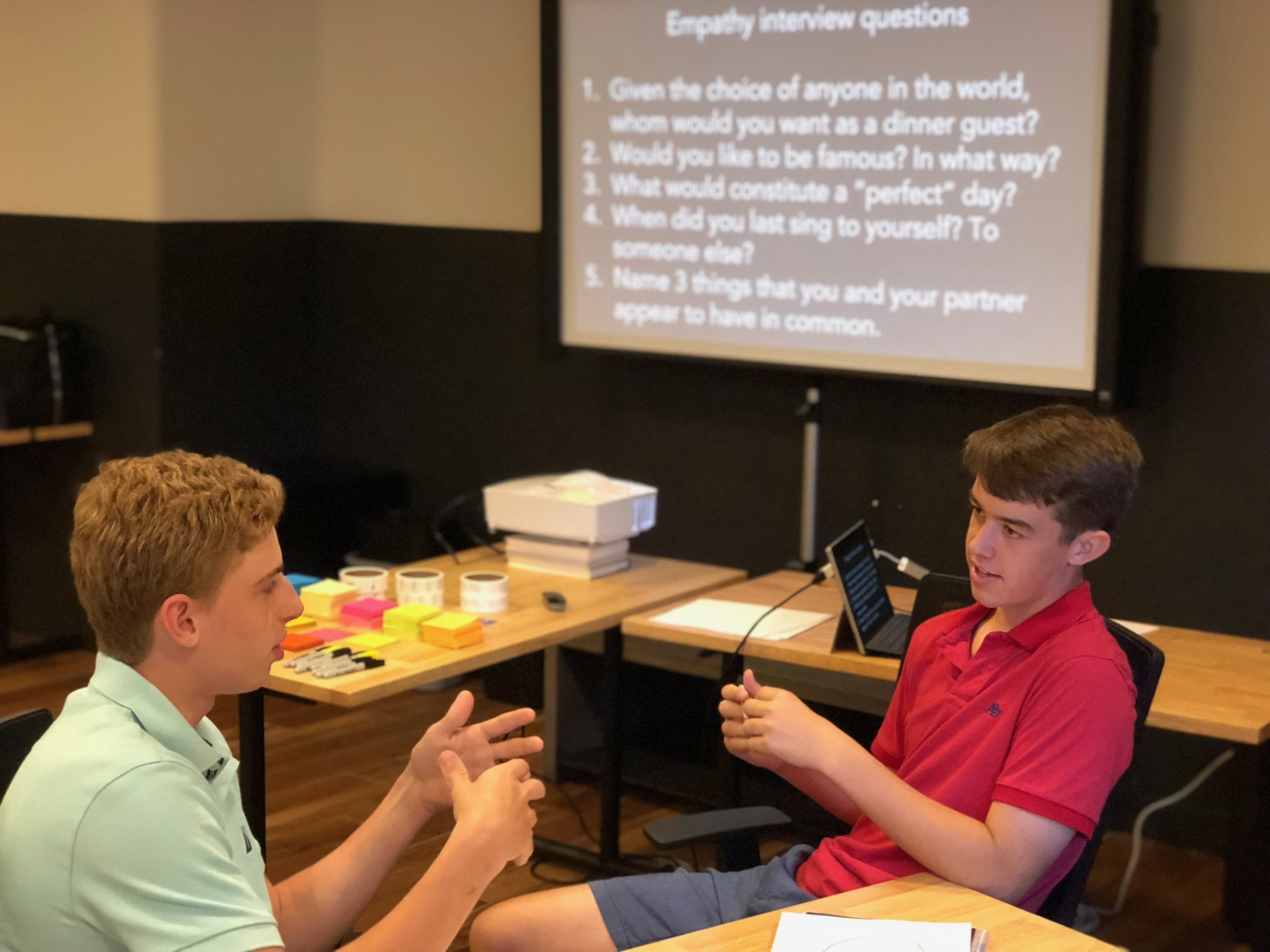 Regis High School teammates do empathy interviews to get to know one another better. This exercise also prepares them to do empathy research as they imagine the user whom they want to serve.