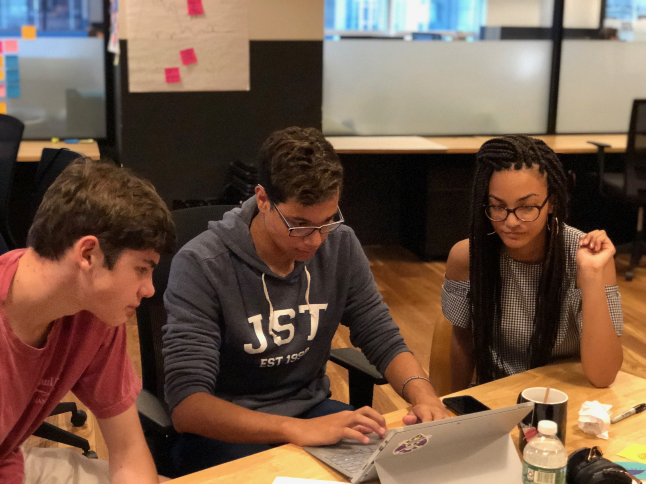 A moment from  Expeditionaries  July 2018, which took place in WeWork W. 57th Street. Students from Fordham Prep and Bishop Kearney worked in separate teams, but on a regular basis would provide one another feedback and push one another's learning. WeWork's flexible co-working space could just as easily be a school's flexible co-learning space…