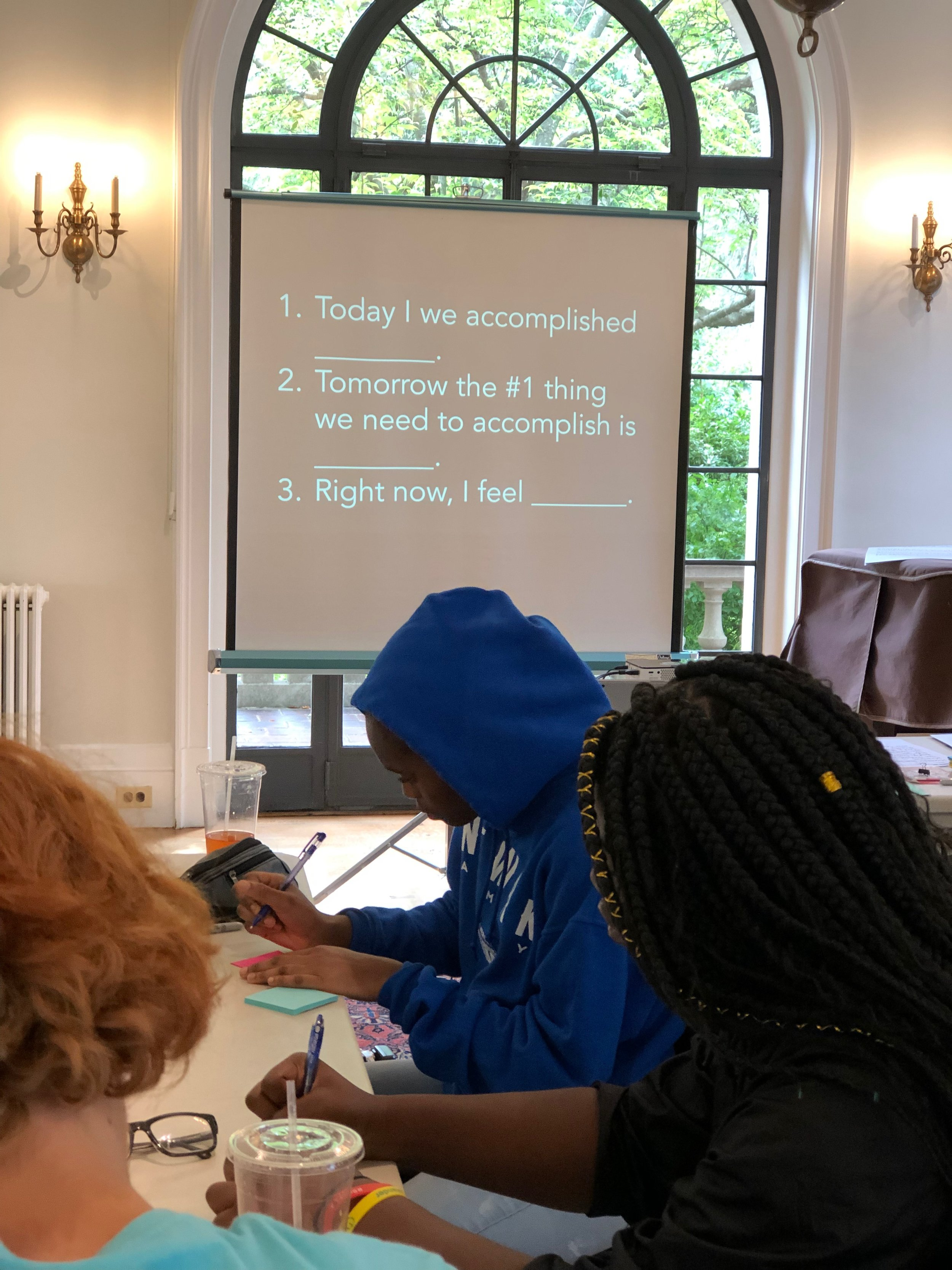 Students from Benedictine Academy and St. Benedict's Prep engage in an end-of-day reflection that consolidates learning by addressing both the head and the heart.