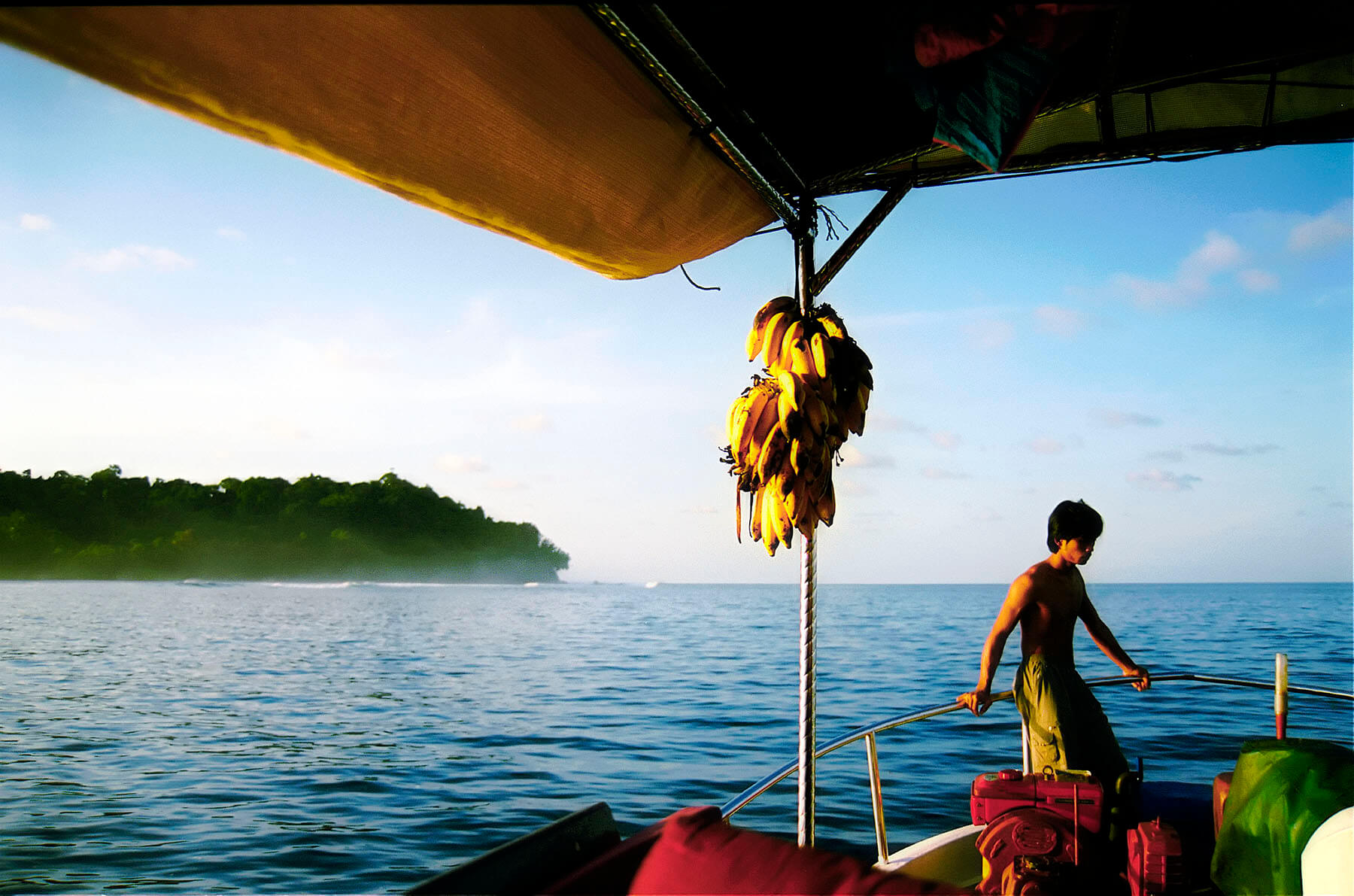 A quiet moment for a crew member while on a surfing boat trip to the Banyak Islands in Bandah Aceh.