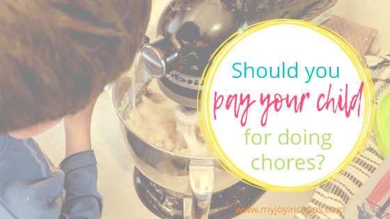 boy helping bake and the question should you pay your child for doing chores in a circle