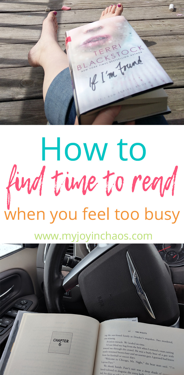 book set on legs and resting on steering wheel