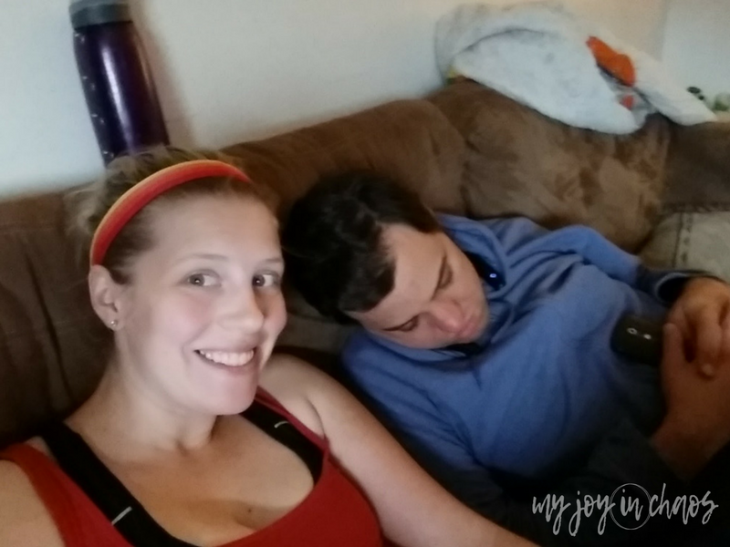 wife with sleeping husband on couch