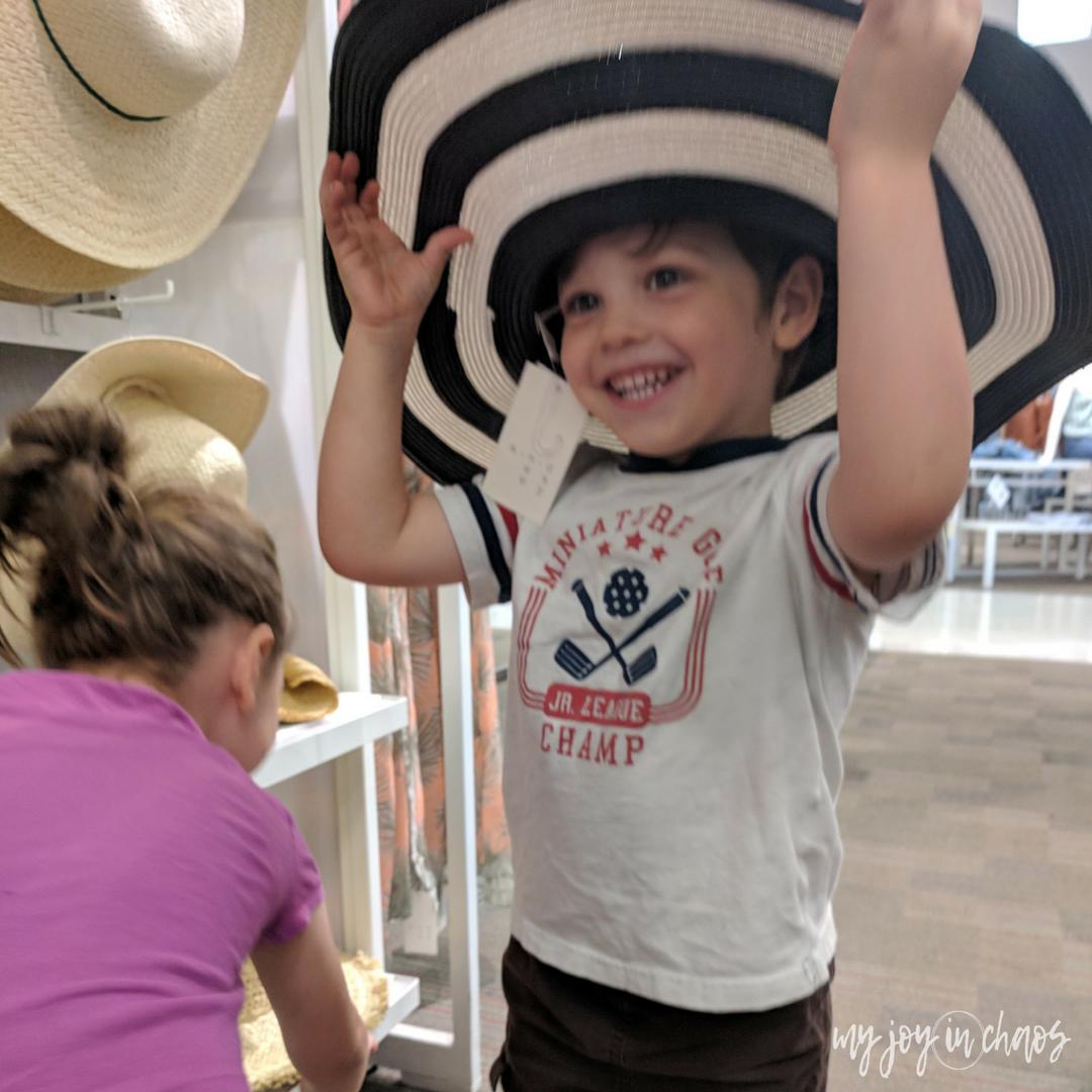 little boy wearing silly hat