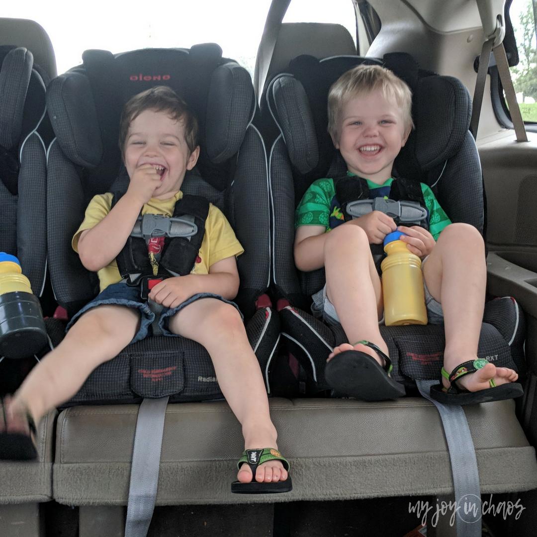 waiting in the car - 3 car seats across - diono radian car seats