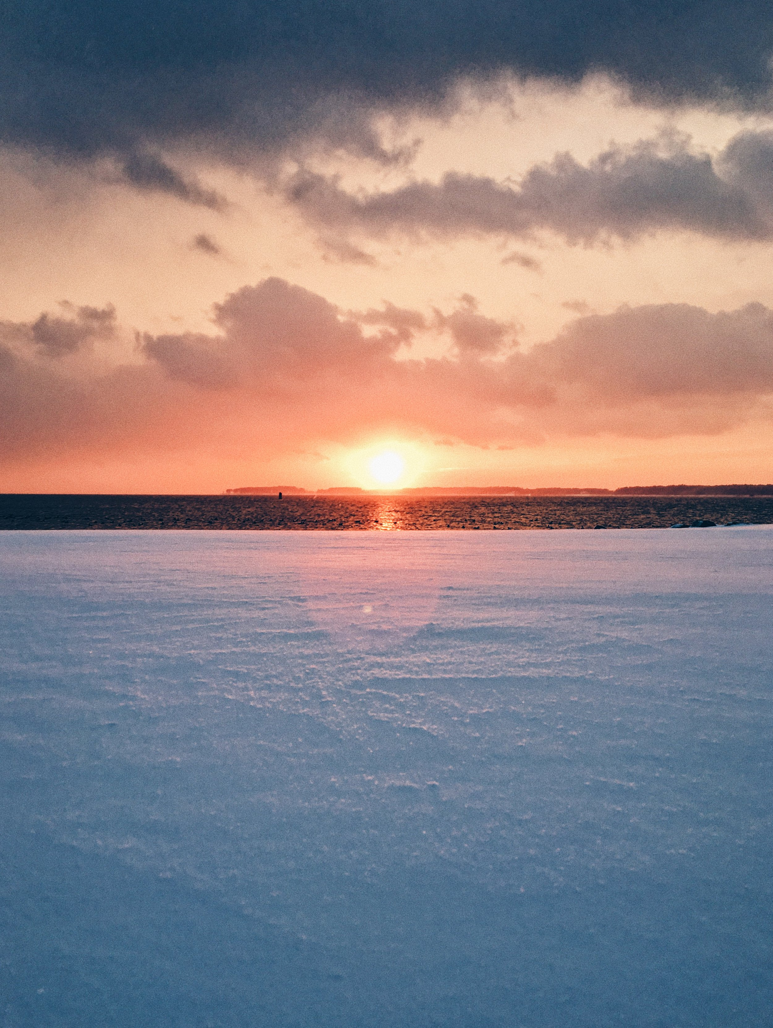 Sunset on the snow and water at Trinity Fellows Academy
