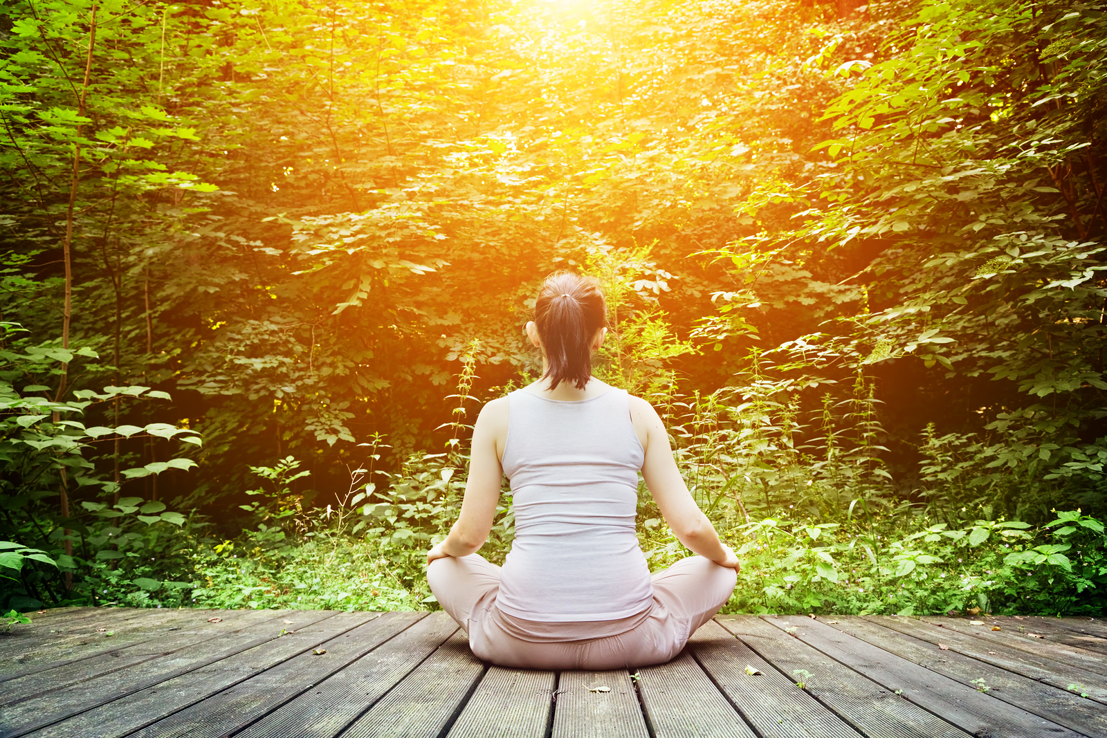 bigstock-Young-woman-meditating-in-a-fo-68759434.jpg