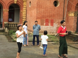 Myanmar family on a visit to the Secretariat, an important building in Yangon opened to the public only once per year, on Martyrs' Day, which is marked annually on July 19.  Source: Ronda Zelezny-Green