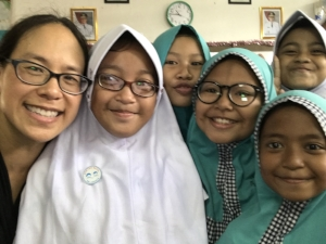 Tanya with schoolgirls in West Papua, Indonesia, where a real-time information innovation helped to improve the coverage of an immunization campaign for 35 million children.