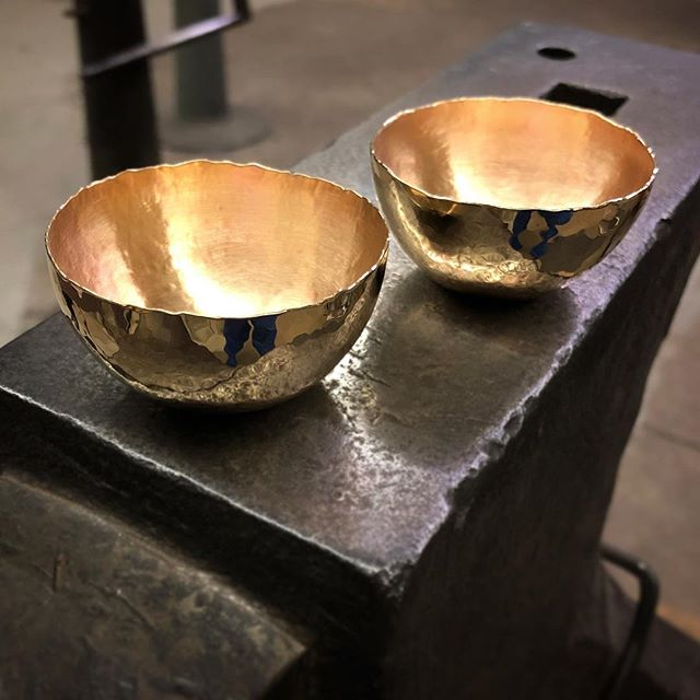 Hand raised bronze sake cups.  Each cup starts as sheet, which I then hammer over a steel stake in concentric circles. Hundreds of hammer blows later, here they are ✨  I will have these and some gorgeous copper bowls from my bae @koalasandco for sale at @handmadearcade this weekend!