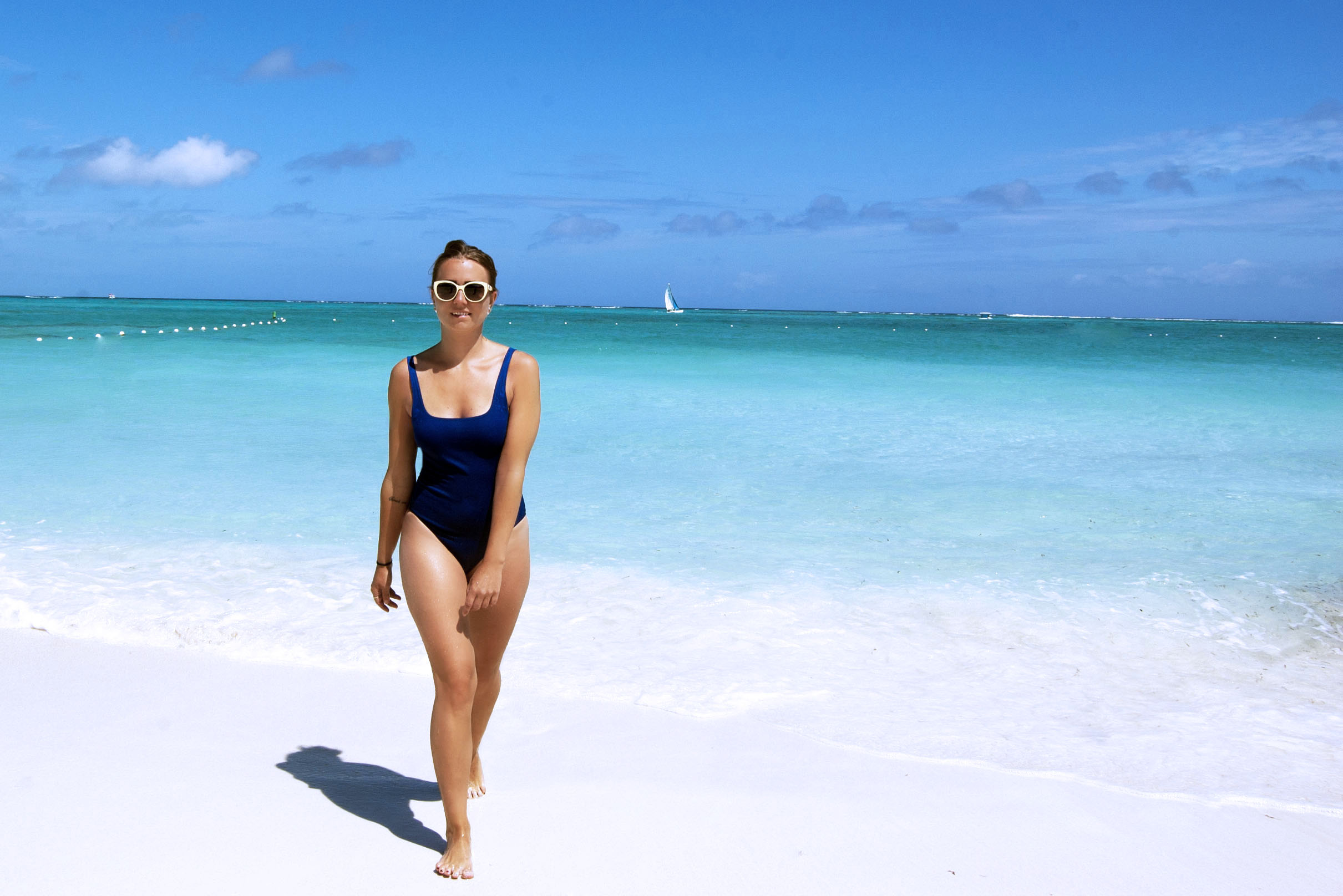 I am wearing vintage sunglasses, fin similar  here  // swimsuit from Zara, find similar  here .