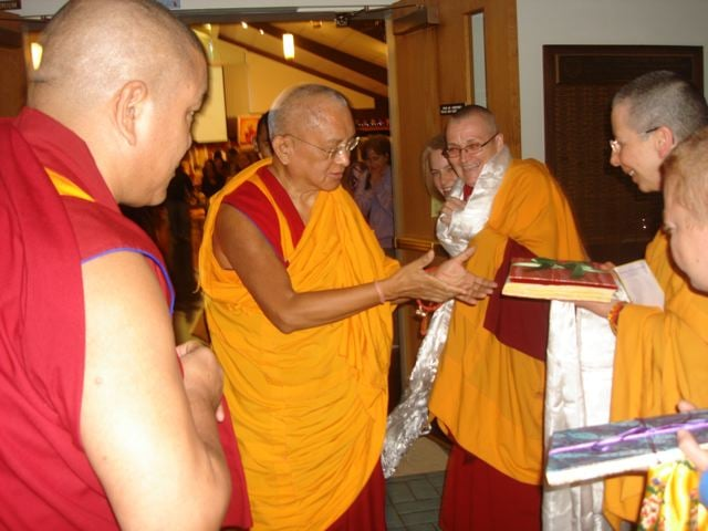 Kyabje Lama Zopa Rinpoche being presented with the Noble Sanghata Sutra by Ven. Thubten Chokyi and Ven. Katy Cole from the Liberation Prison Project, 2009